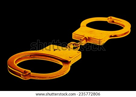 handcuffs background  - stock photo