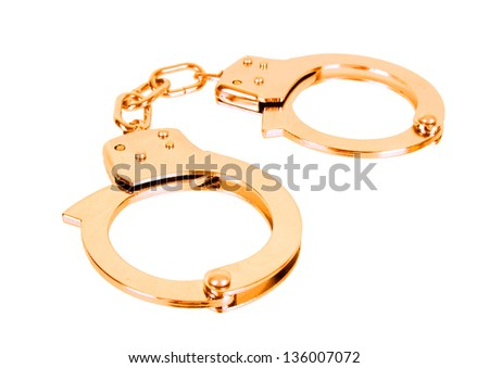 handcuffs gold isolated in white background - stock photo