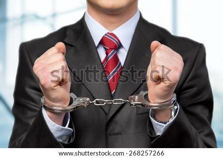 Handcuffs. Illegal - stock photo