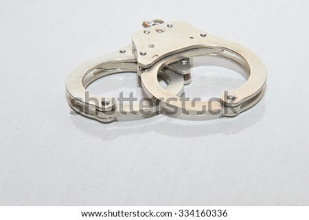 Handcuffs isolated on white background - stock photo