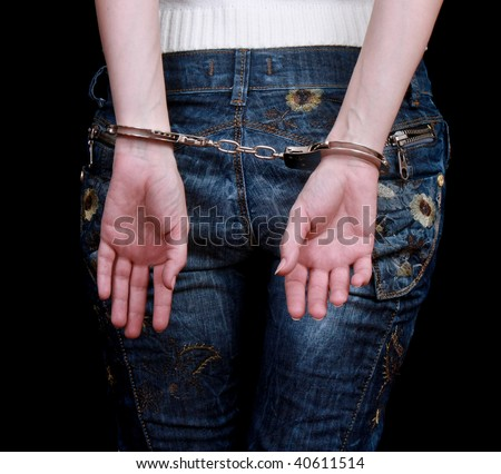 handcuffs on hands - stock photo