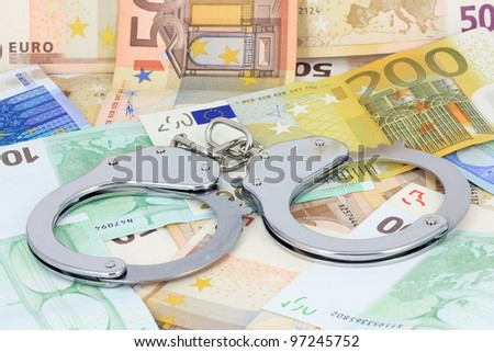 Handcuffs on the money - stock photo