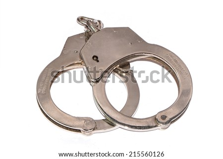 Handcuffs on white background - stock photo