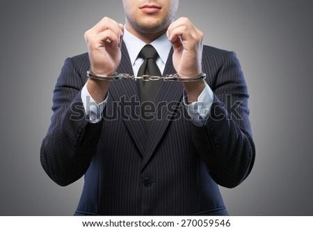 Handcuffs, White Collar Crime, Arrest. - stock photo