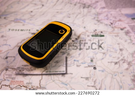 Handed GPS and Map - stock photo