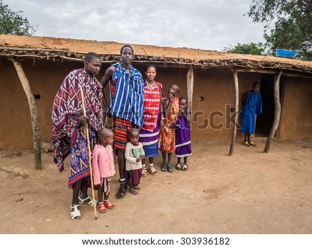 HANDENI, TANZANIA - AUGUST 01, 2015: Maasai family wearing traditional everyday clothes in their boma (village) in Tanzania, Africa.