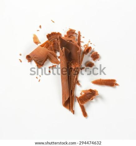 handful of chocolate shavings on white background - stock photo