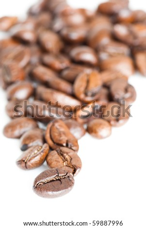 handful of coffee beans on white background - stock photo