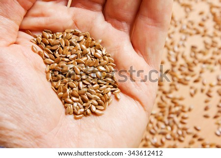 handful of flax seeds in your hand