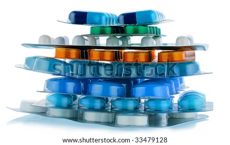 handful of packing different pills on white - stock photo
