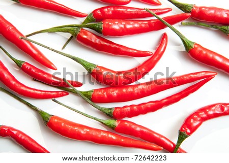 Handful of red hot Thai chili papers on white background - stock photo