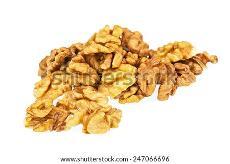 Handful of walnuts isolated on white background. Closeup. Selective focus. - stock photo