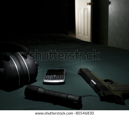 Handgun and self-defense get on a bed with light in the hallway ...