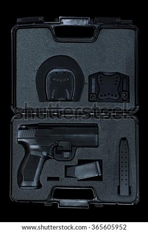 Handgun in black case - stock photo