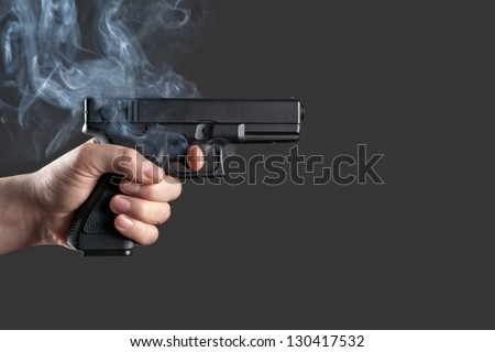 handgun in men hand closeup - stock photo