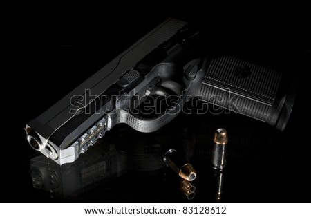 handgun on a glass bedstand in the middle of the night - stock photo
