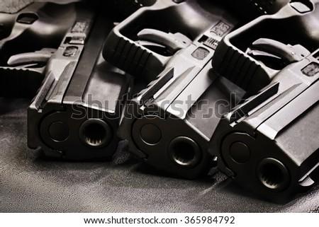 handgun on the black background - stock photo