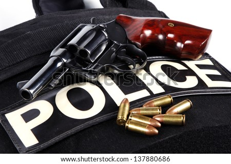 Handgun revolver with bullets and Bullet-proof vests - stock photo