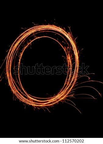 Handheld fireworks circular sparks flying - stock photo