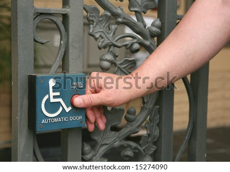 Handicap Access Automatic Door Button Being Pushed by a Gentleman - stock photo