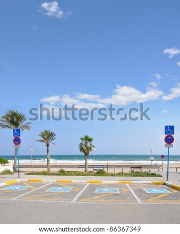 Handicap Parking Lot at Beach on Beautiful Sunny Blue Sky Day - stock photo
