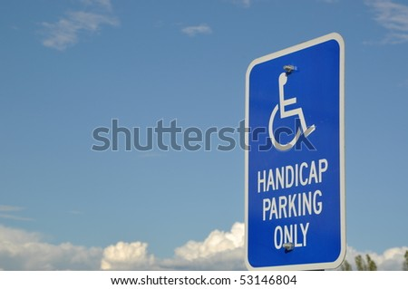 Handicap parking only sign with blue sky - stock photo