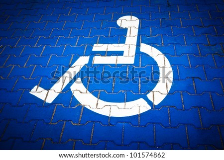 handicap parking only sign with wheelchair icon - stock photo