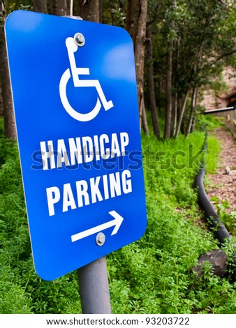 handicap parking  sign in a green forest - stock photo