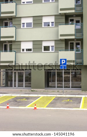 Handicap parking space just painted. Universal wheelchair symbols painted on the asphalt. - stock photo