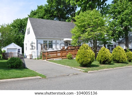 Handicap Ramp Middle Class Suburban Cape Cod Home in Residential Neighborhood - stock photo