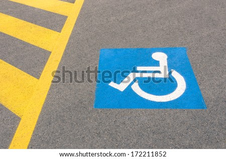 Handicap road sign Parking spots - stock photo