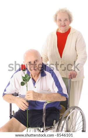 handicap senior with wife - stock photo