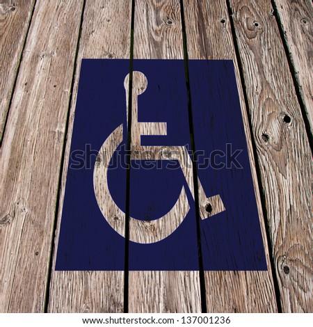 handicap sign on boardwalk - stock photo