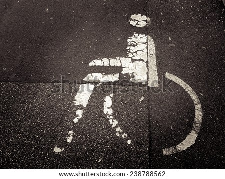 handicapped parking sign painted on asphalt - stock photo