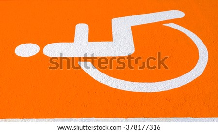 Handicapped symbol on parking space - stock photo