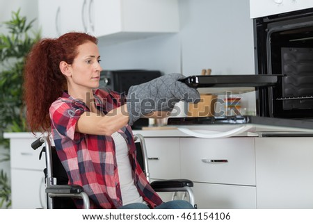 handicapped woman cooking