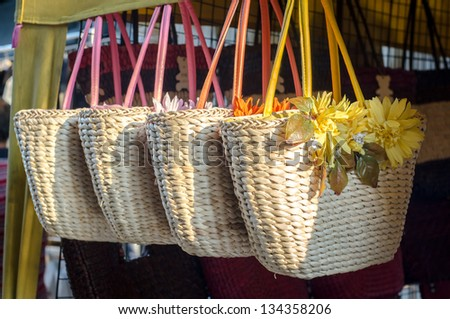 Handicraft bags hanging in row for purchasing - stock photo