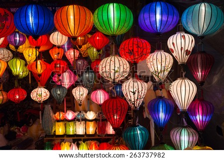 Handicraft colorful lamps illuminated at night, in Ha Noi, Vietnam - stock photo