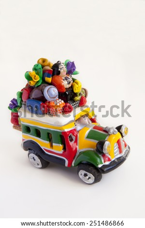 Handicraft representing a typical bus from Colombia, known as �chiva�. Colombian handicrafts bus.