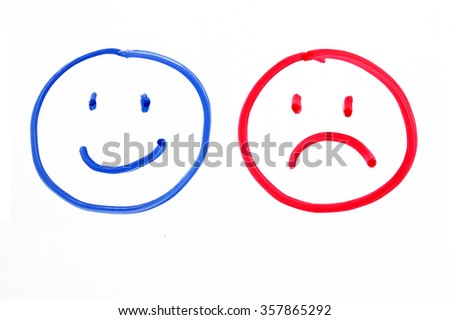 Handing drawing faces emotions on whiteboard - stock photo