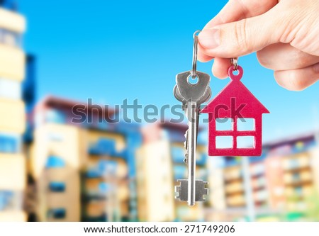 Handing keys in the house background - stock photo