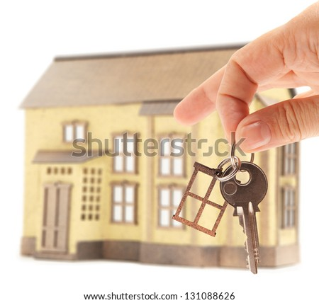 Handing keys in the house background  isolated - stock photo