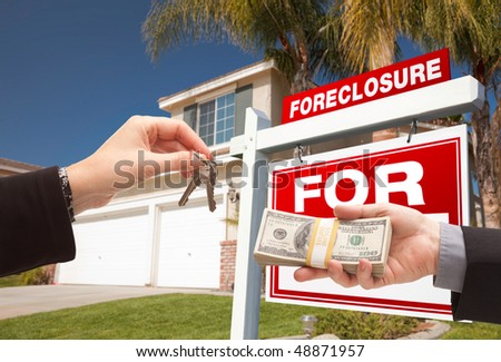 Handing Over Cash For House Keys in Front of House and Foreclosure Sign - stock photo