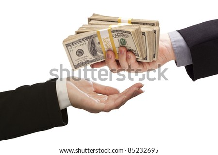 Handing Over Stacks of Cash to Other Hand Isolated on a White Background. - stock photo