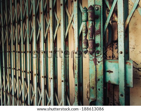Handle of old metal door - stock photo