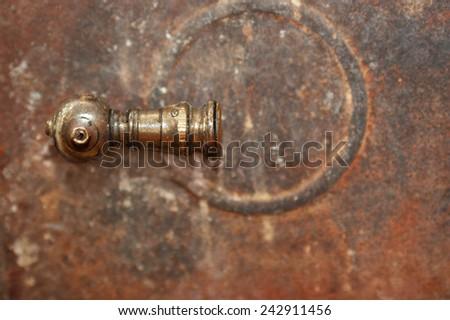 Handle on an old rusty metal door - stock photo