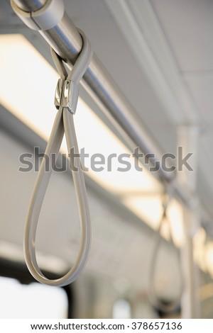 Handle on light rail - stock photo