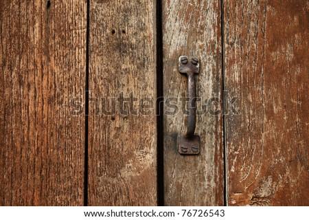 Handle on the old wooden door - stock photo