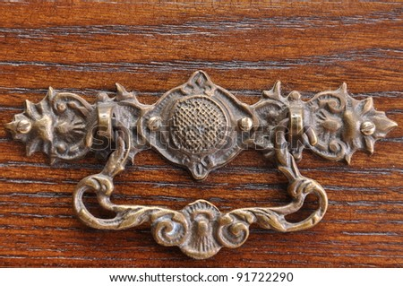Handle to the old drawer full of mysteries - stock photo