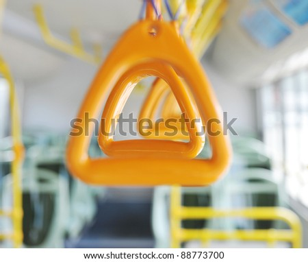 Handles for standing passenger inside a bus.